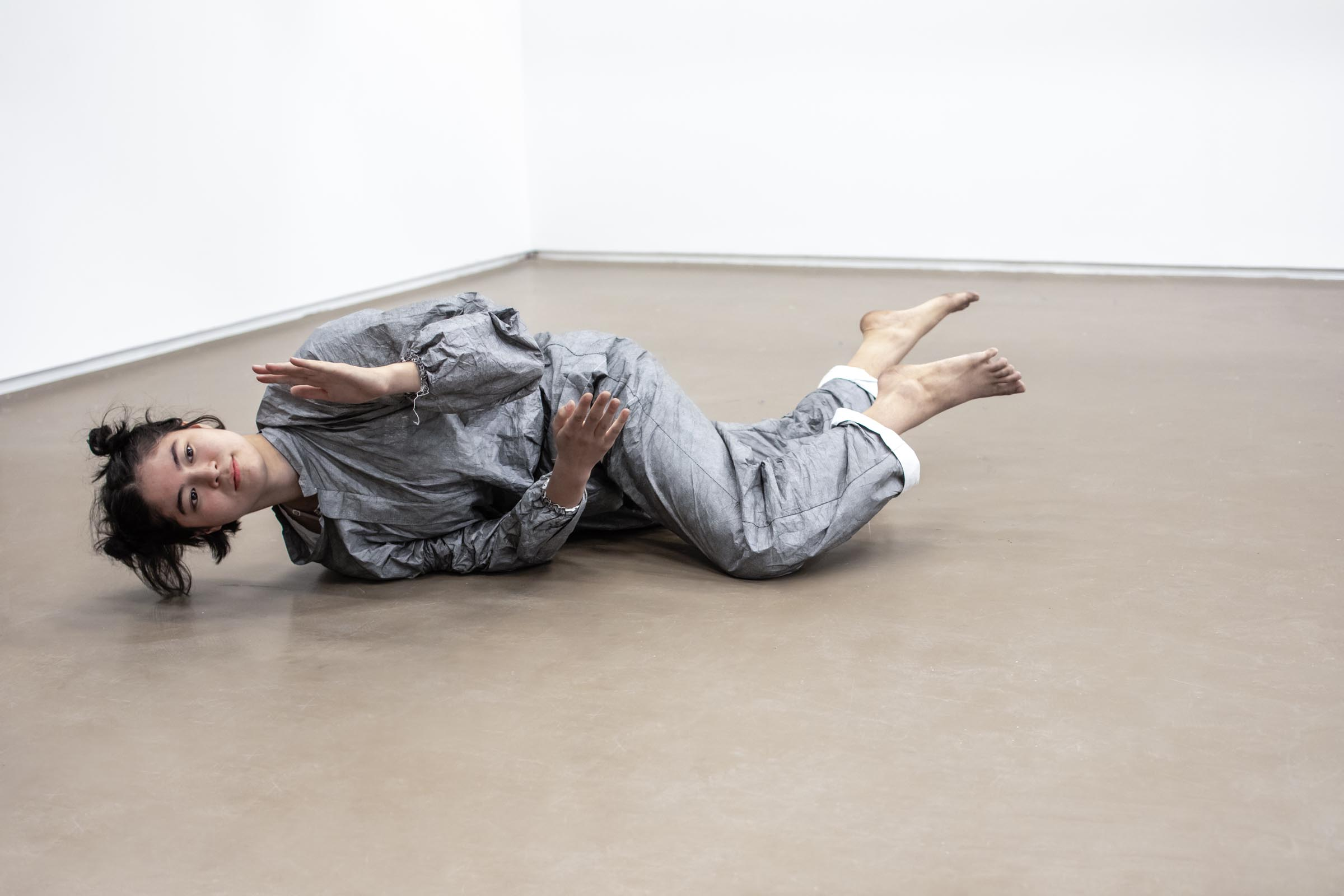 Elena Bajo (USA/ES) is an artist, choreographer and cofounder of the LA collective D'CLUB dedicated to climate action.