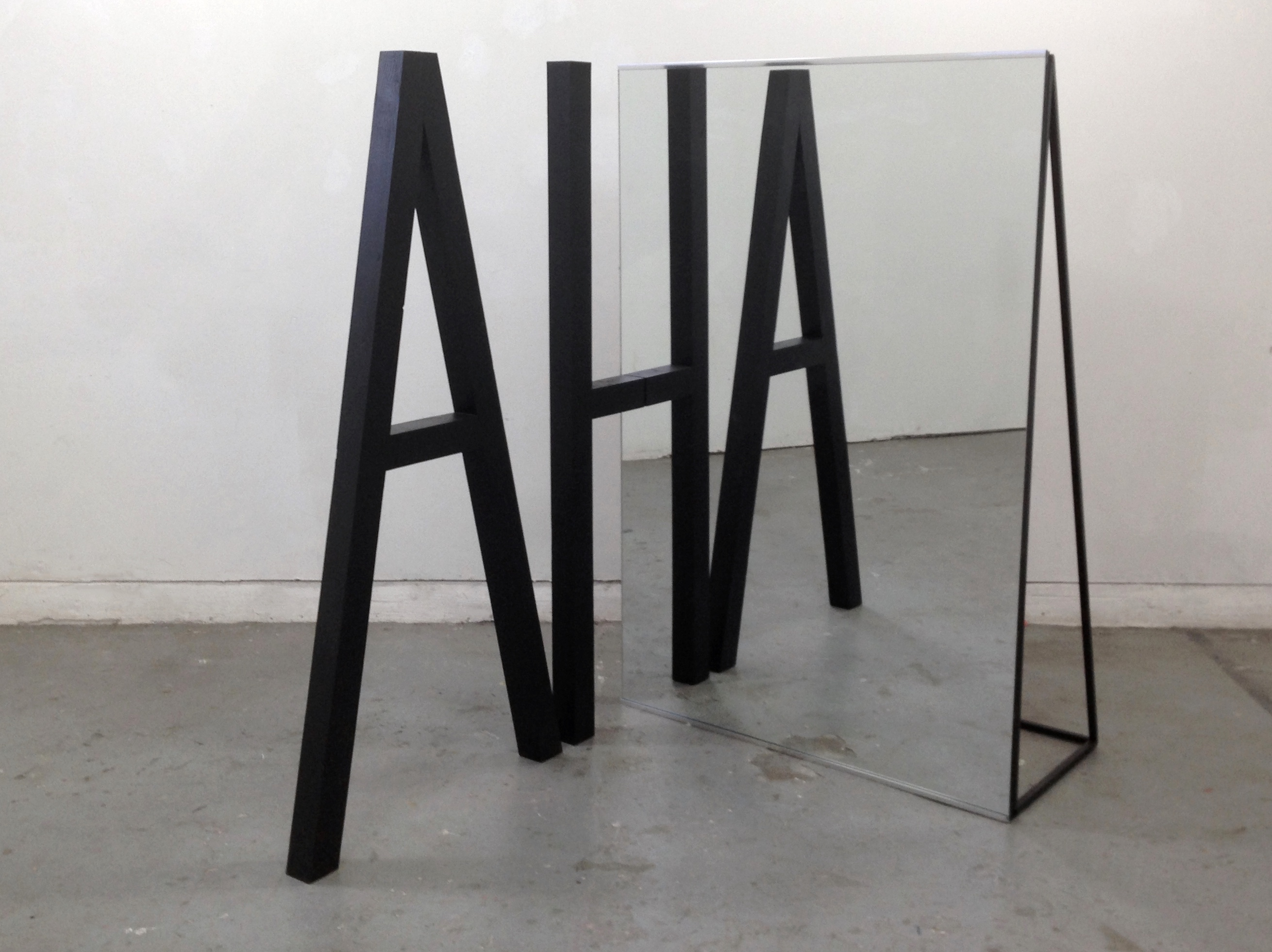"Alicia Eggert, AHA, 2013 Mirror, plywood, steel, paint, sandbags 72"" x 72"" x 48"""