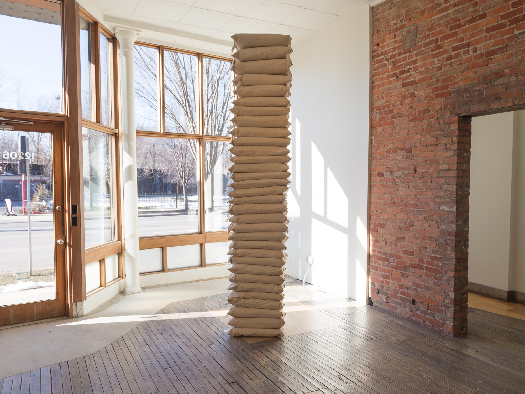 Anthony Warnick, Infinite Sleep 2018 Prisoner Produced Pillows Dementions Variable A pillar created from 32 textured vinyl covered pillows produced by and for those incarcerated.