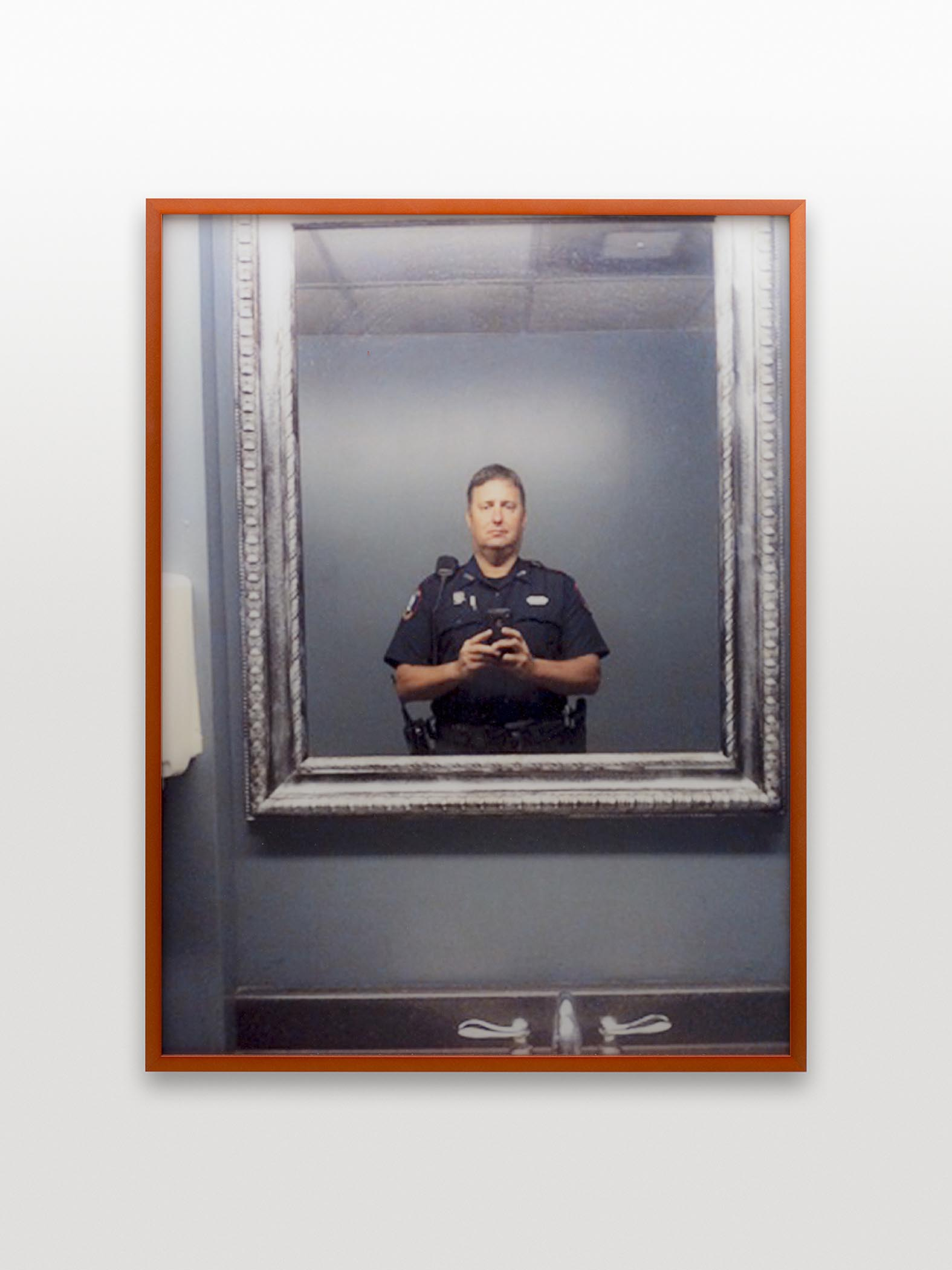 Brute-force: xtxp8.jpg (cop selfie), 2014 Framed archival inkjet print, 20x30 in Individual user cell phone photographs stolen via brute-force sever attack.