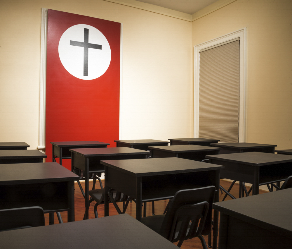 Daniel McCarthy Clifford, McCarthyism, 2014, enamel on panel, found school desks and chairs dimensions variable