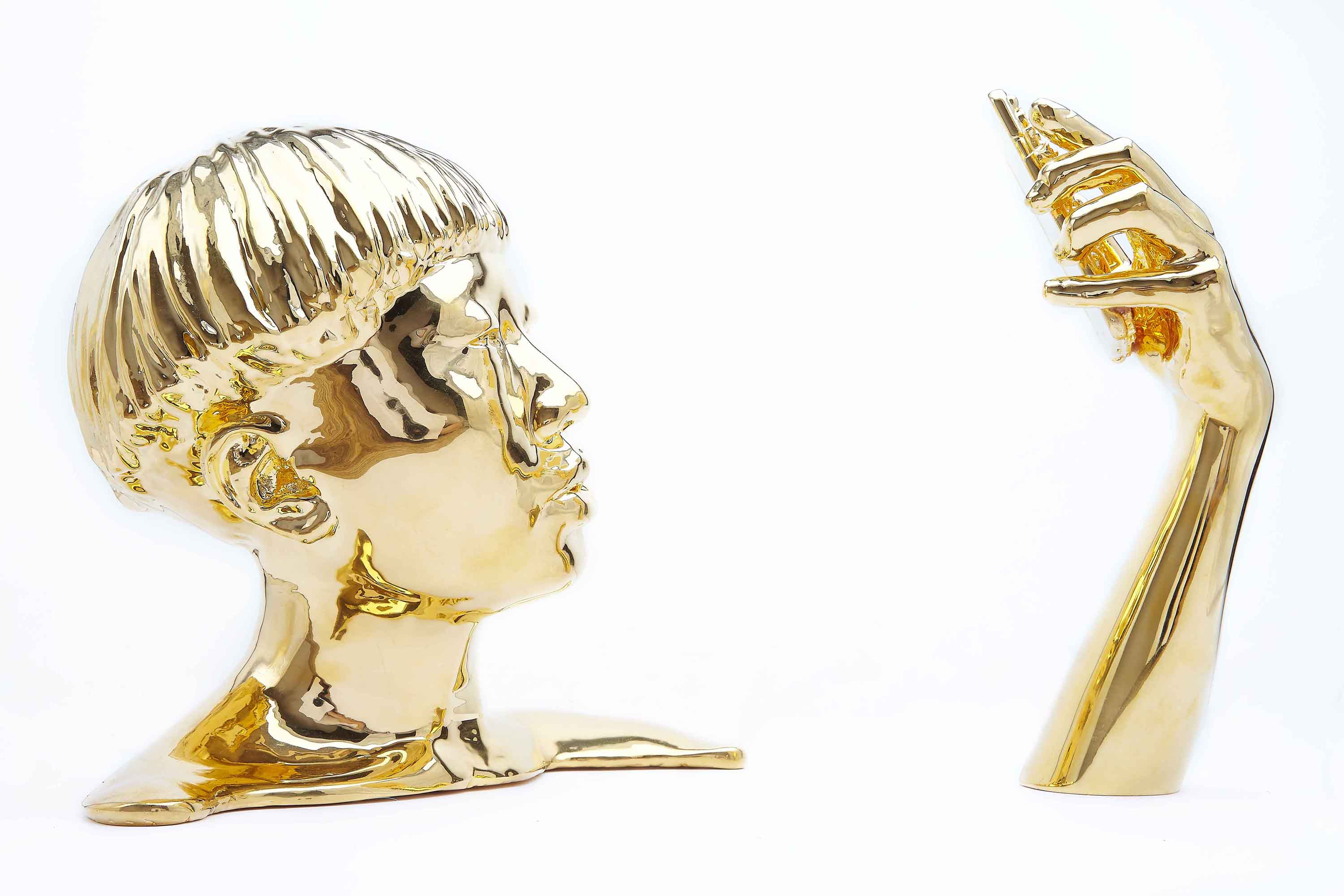Untitled (JiaJai Fei), 2017, 3D print coated in 24 carat gold, height: 13 in., front of arm to back of head: 20 in. (variable), shoulder to shoulder: 14 in.