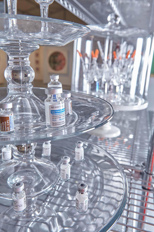 Fertility detail, 2017, 3 tiered dessert stand, Waterford crystal, Follistim vials, Menopur vials, Leuprolide Acetate vials, Sodium Chloride vials, Pregnyl vials, needles