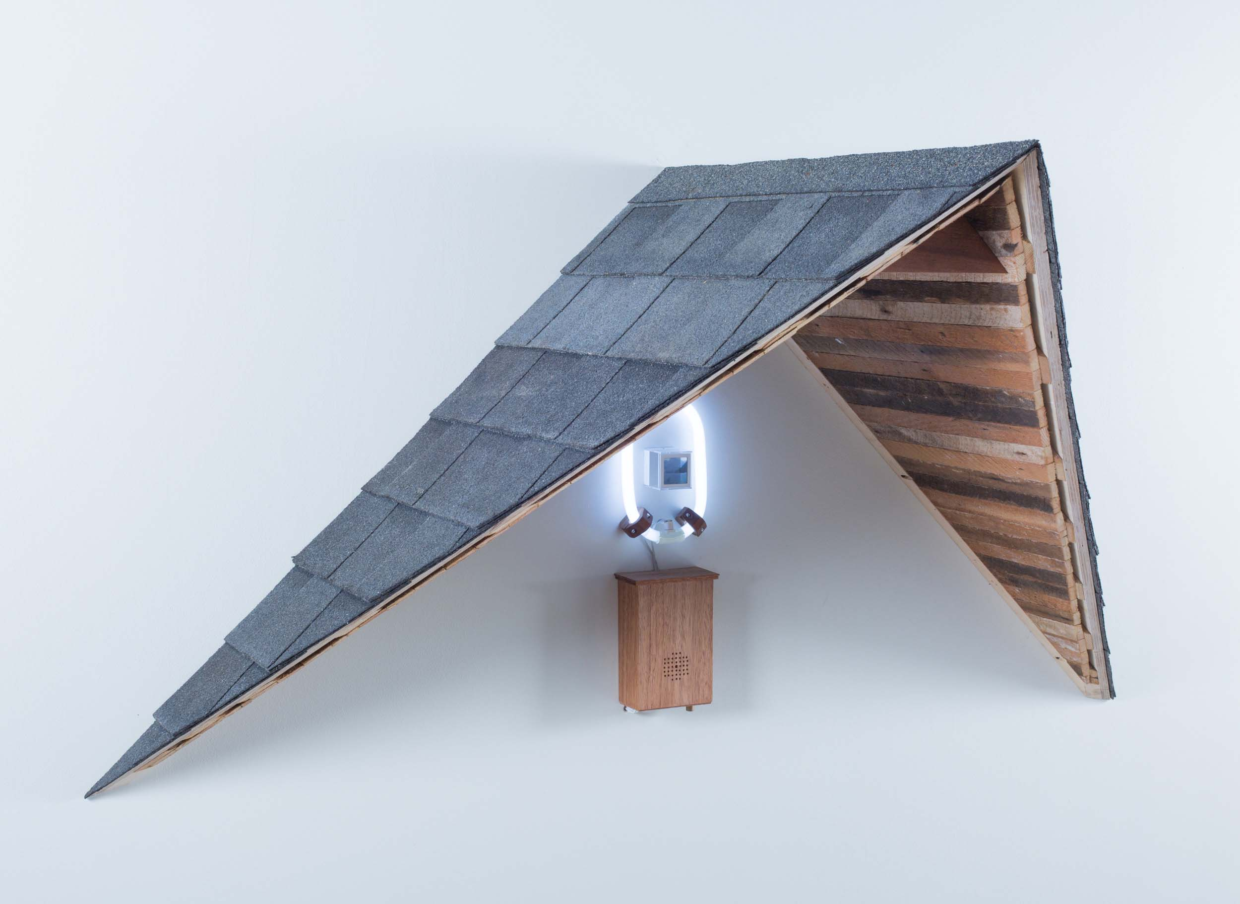 "Mark Baugh-Sasaki, Uncanny Valley Color 35mm slide, Plexiglas, electronics, fluorescent light, speaker, audio recording, plywood, lath, roofing shingles 36"" x 72"" x 36"" 2019"