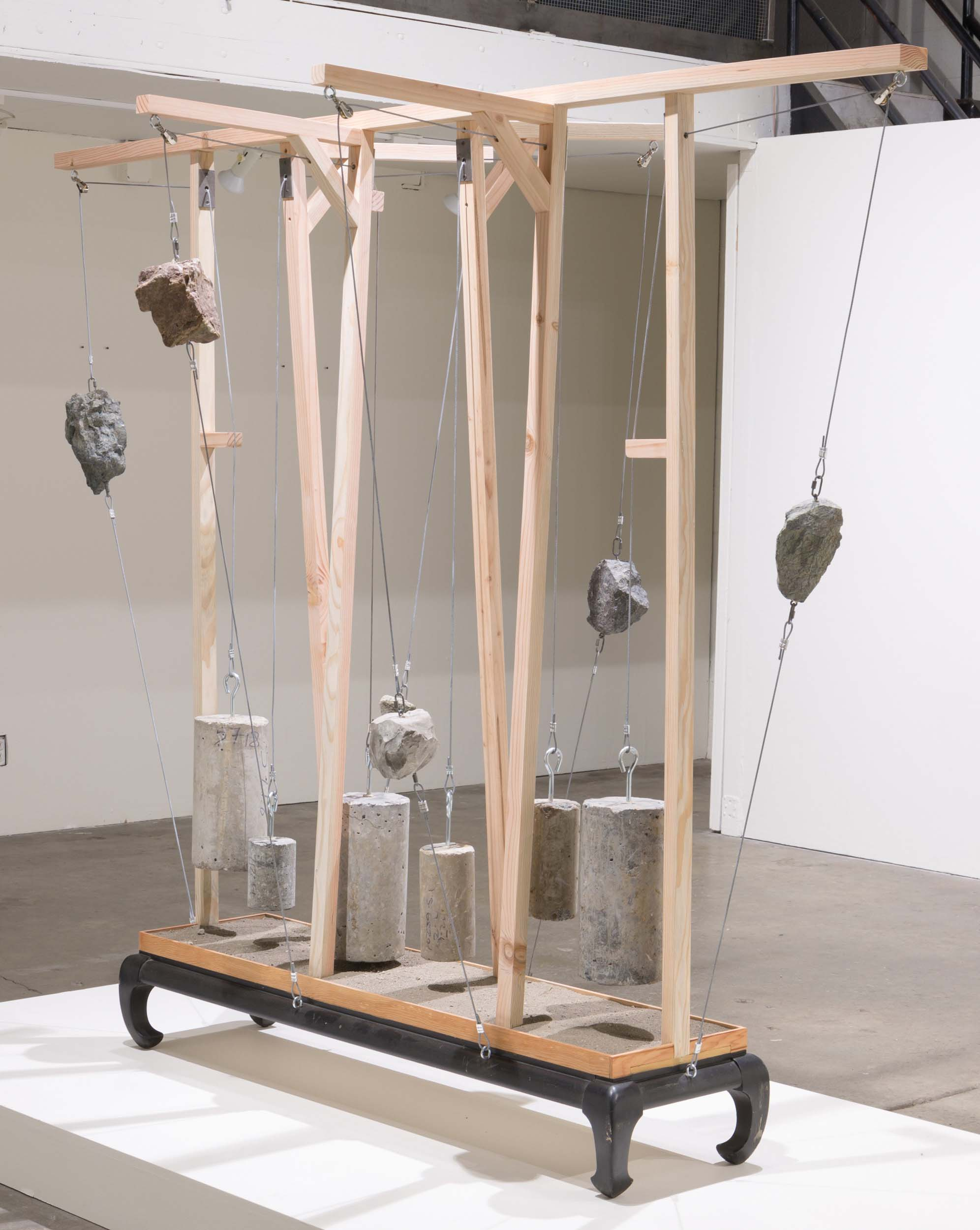 "Mark Baugh-Sasaki, Willing Suspension Concrete, San Francisco bedrock (chert, shale, serpentine), earth, wood, steel cable and cabinet base 92"" x 44"" x 74"" 2019"