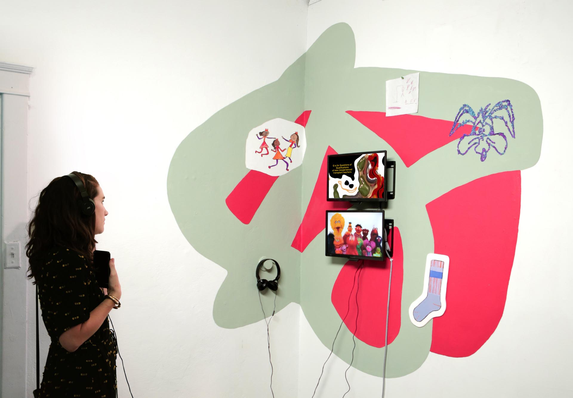 Marta Rodriguez Maleck, Marvin the Martian, 2018, latex paint, sticker paper, glitter, found student sketch, monitor, headphones, Duration : 3 minutes 20 seconds, 5' x 6'