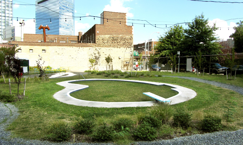 "Backyard Pool 2013 Concrete, ceramic tile, aluminum, fiberglass, seed, acrylic paint 44' x 26' 5"" x 26"""