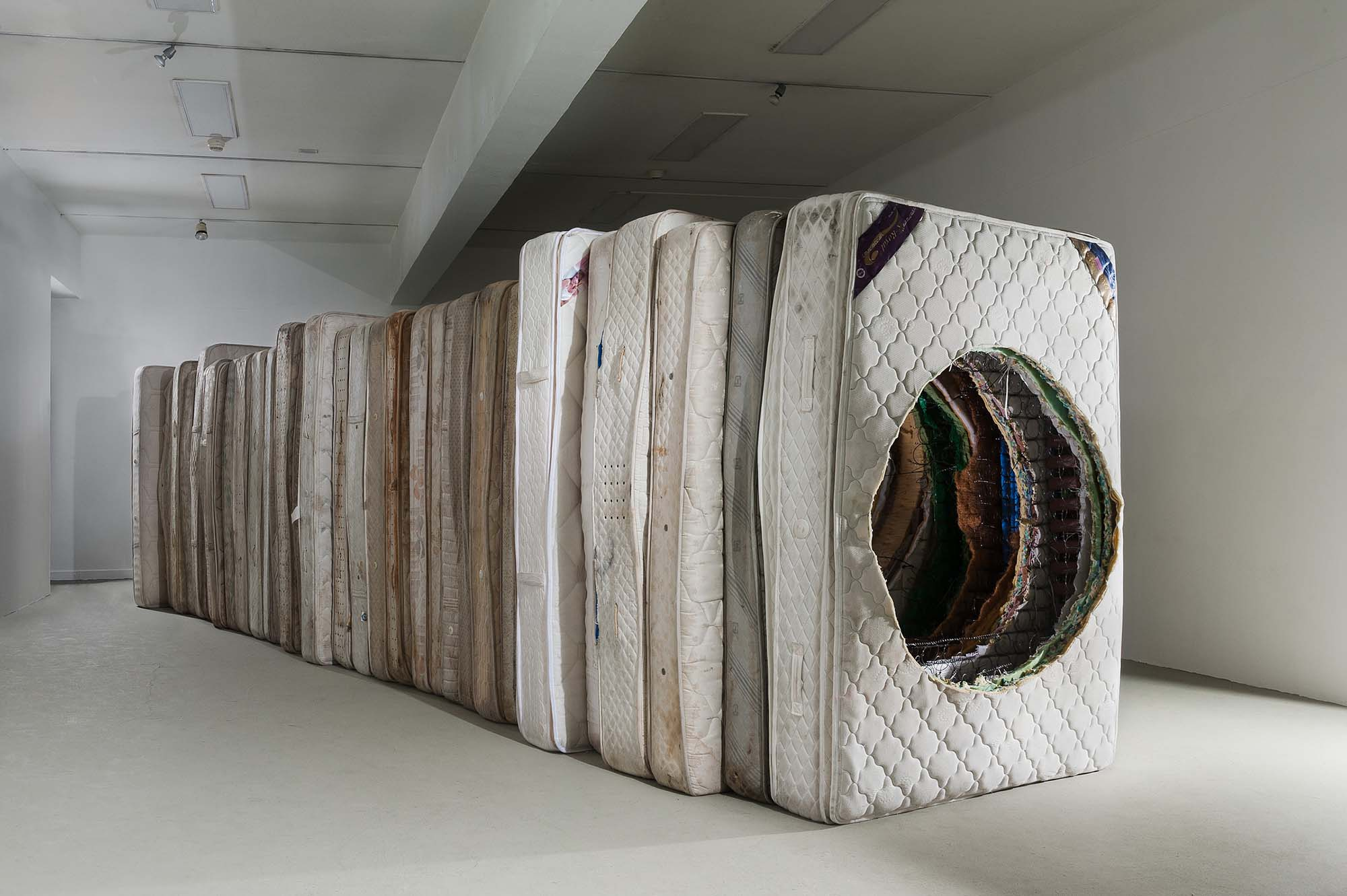 Zac Hacmon, Title: Take Me Back (2015) Media: Mattresses, hooks Dimensions: 28ft x 7ft x 5ft