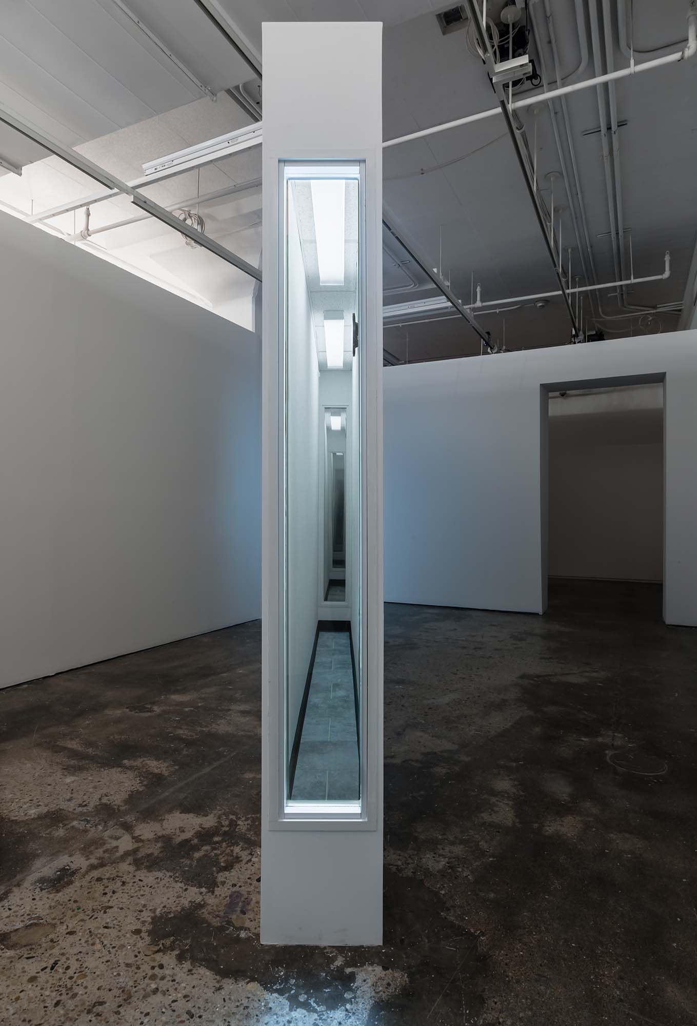 "Zac Hacmon, Title: Capsule (2018) Media: Ceiling tiles, wood, aluminum, glass, plastic tiles, clock Dimensions: 13"" x 96"" x 108"""